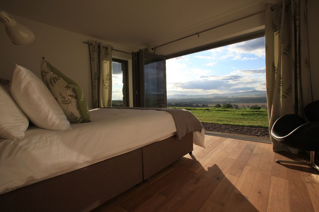 Balbinny Scotland double bedroom with bi-folding doors and stunning countryside views