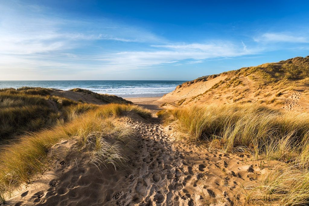 Path through the sand dunes to the beach