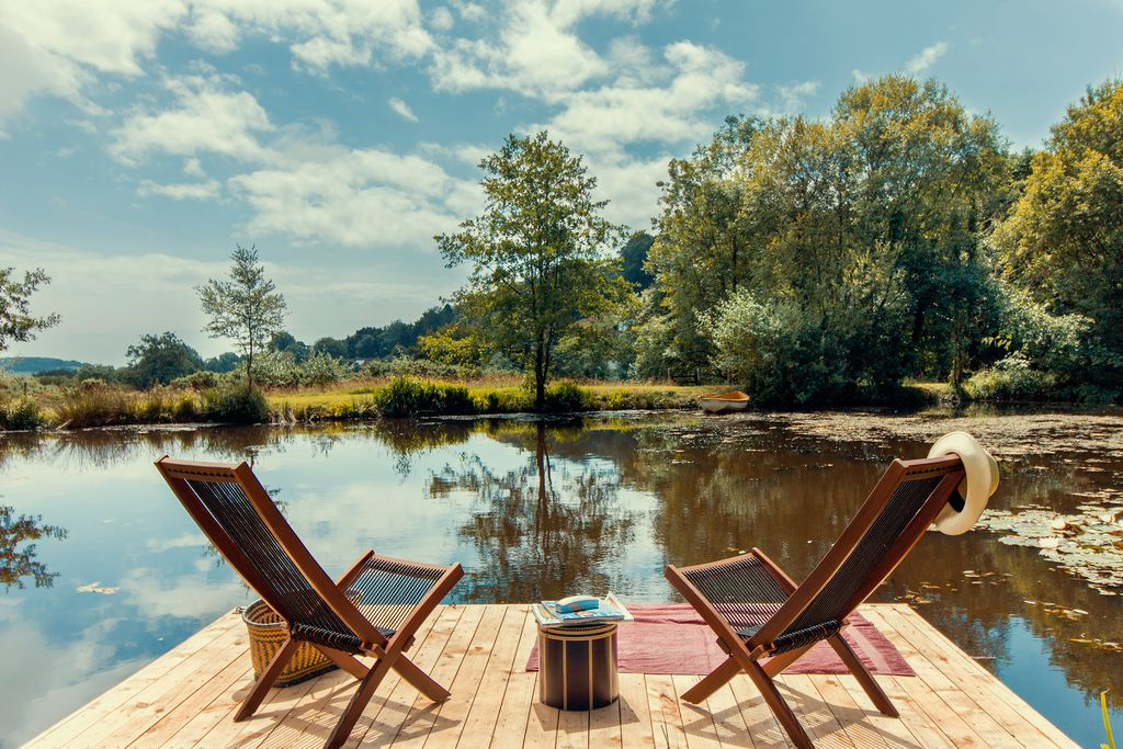 Deckchairs on the pontoon overlooking the lake at The Wellhouse & Wellhayes Barn in Dorset