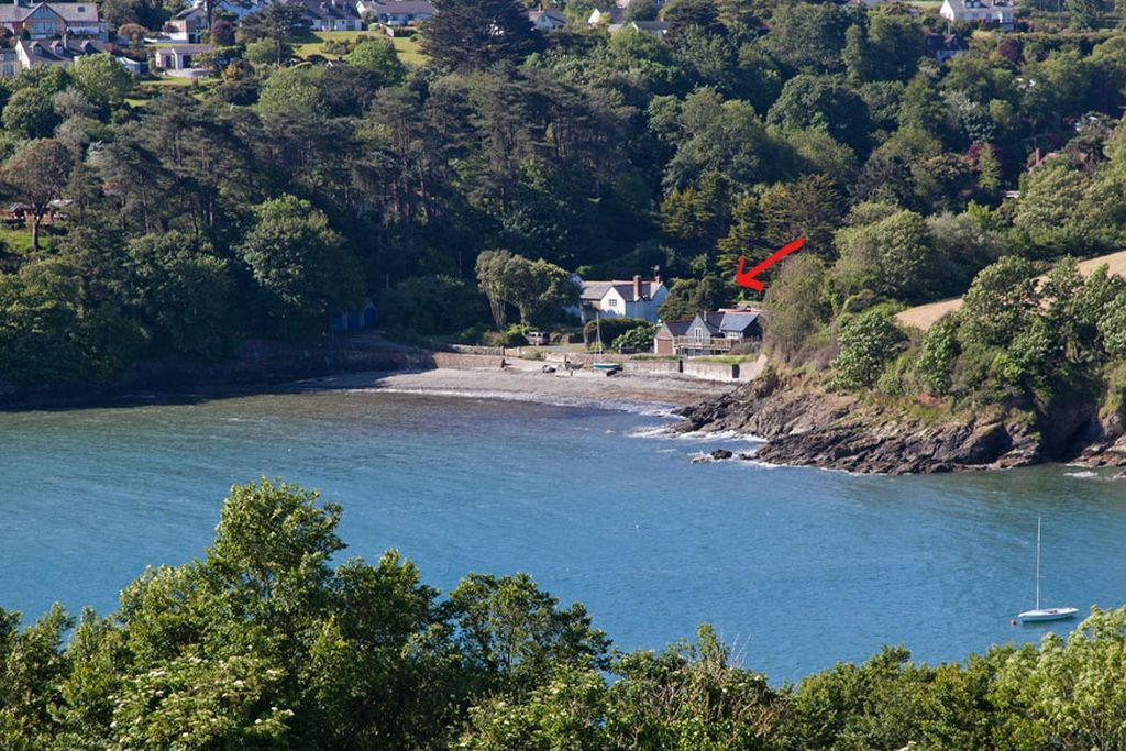 The Boathouse Cornwall is situated right on the beach surrounded by woodland
