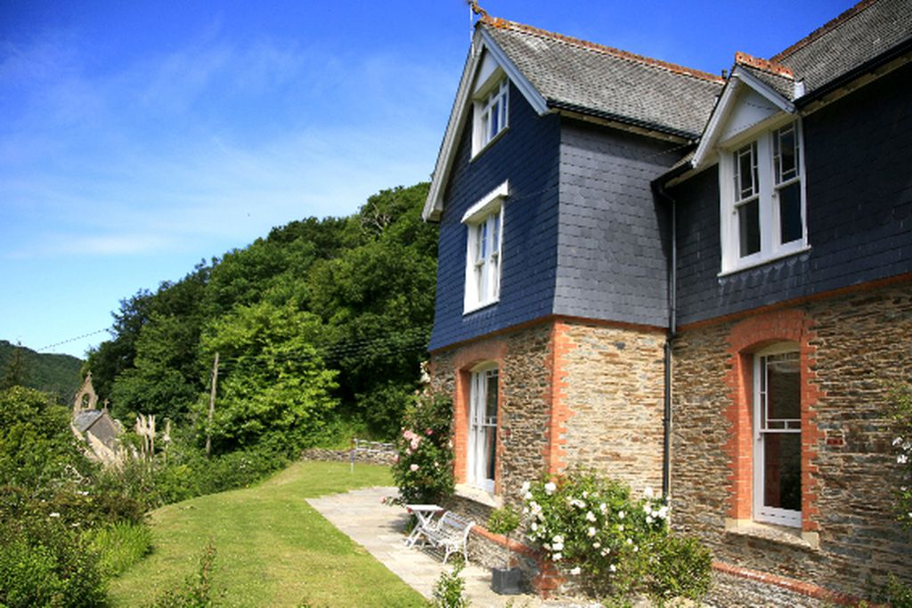 Exterior of The Old Vicarage in Ilfracombe, Devon with lovely garden and outdoor seating