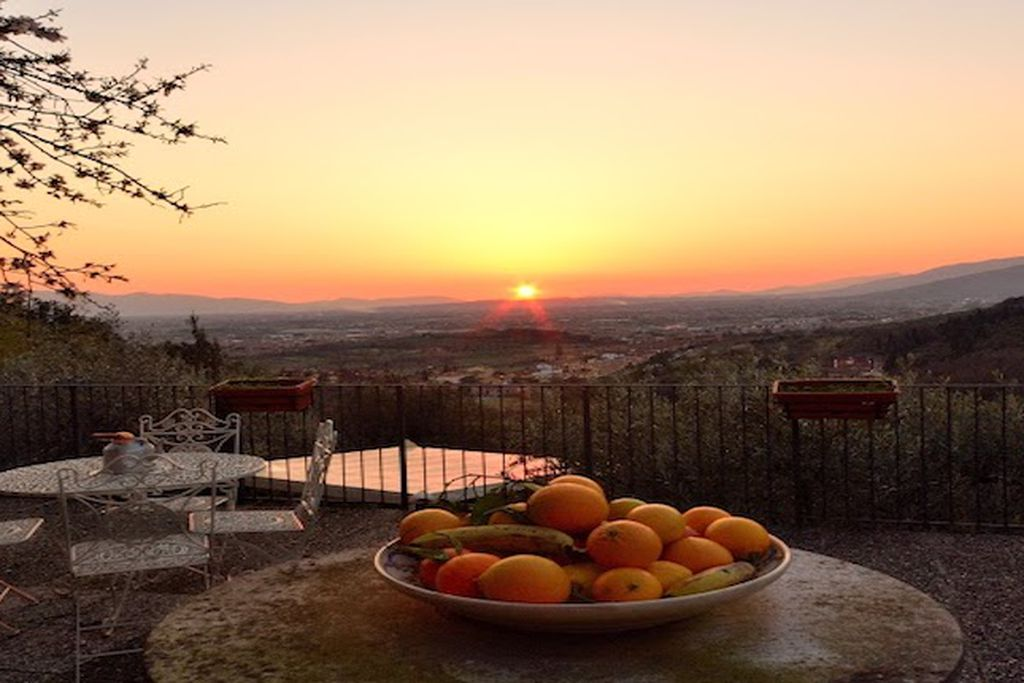 Sunset view from outdoor terrace at Le Maggioline Villa in Tuscany, Italy that stretches for miles and miles
