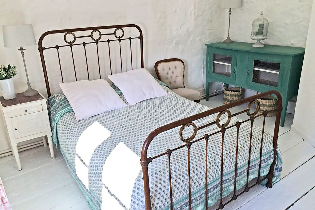 The cosy sea blue master bedroom at The Nook in Shipton Gorge, Dorset