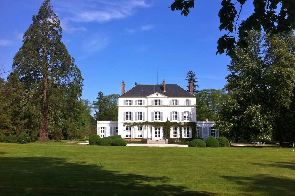 Exterior of Chateau du Bois de la Lune in Normandy, France with expansive grounds