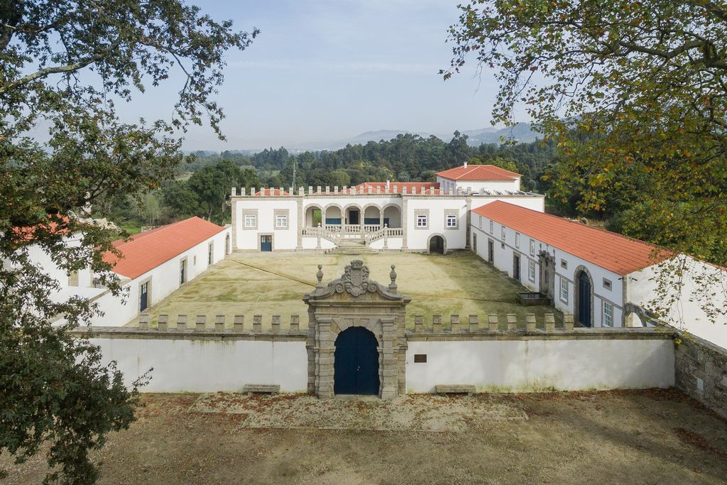 Exterior view of Paco de Vitorino, Ponte de Lima Portugal, white walls, tiles on the roof tops, internal courtyard.