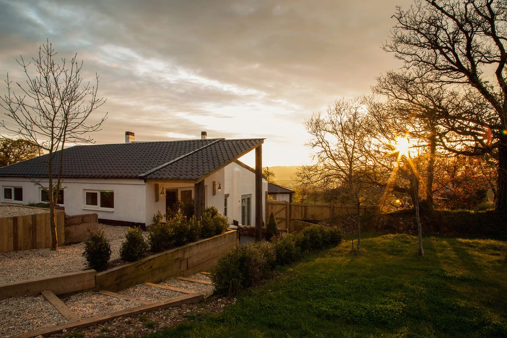Burrow Wood Farm Devon, exterior view of the property with a sunset view