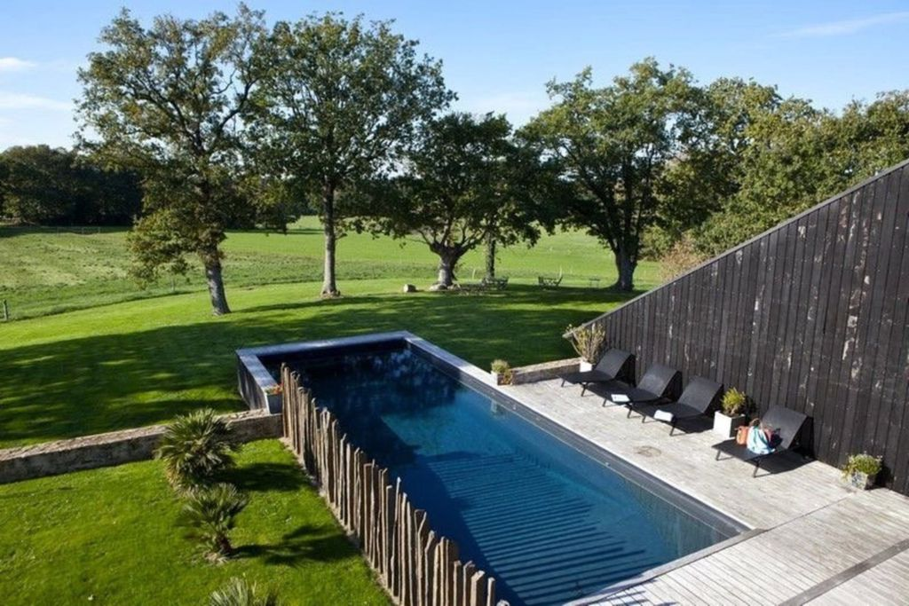 Luxury pool in the garden of Le Clos du Gosquel in Brittany, France with sunbed area