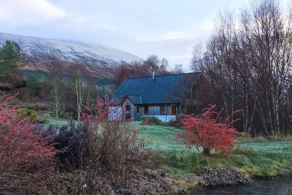 Exterior of Grianain Lodge in Highland, Scotland with mountain views