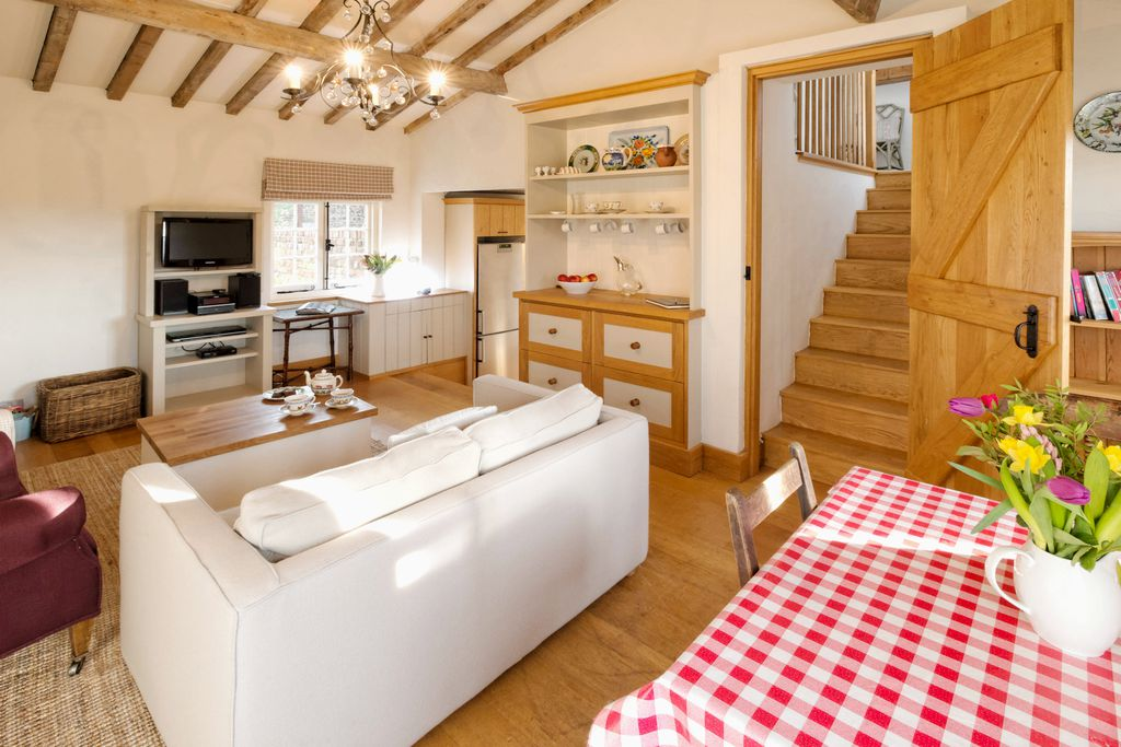 The clean and bright kitchen/lounge at The Cottage at Collfryn Farm in Powys, Wales
