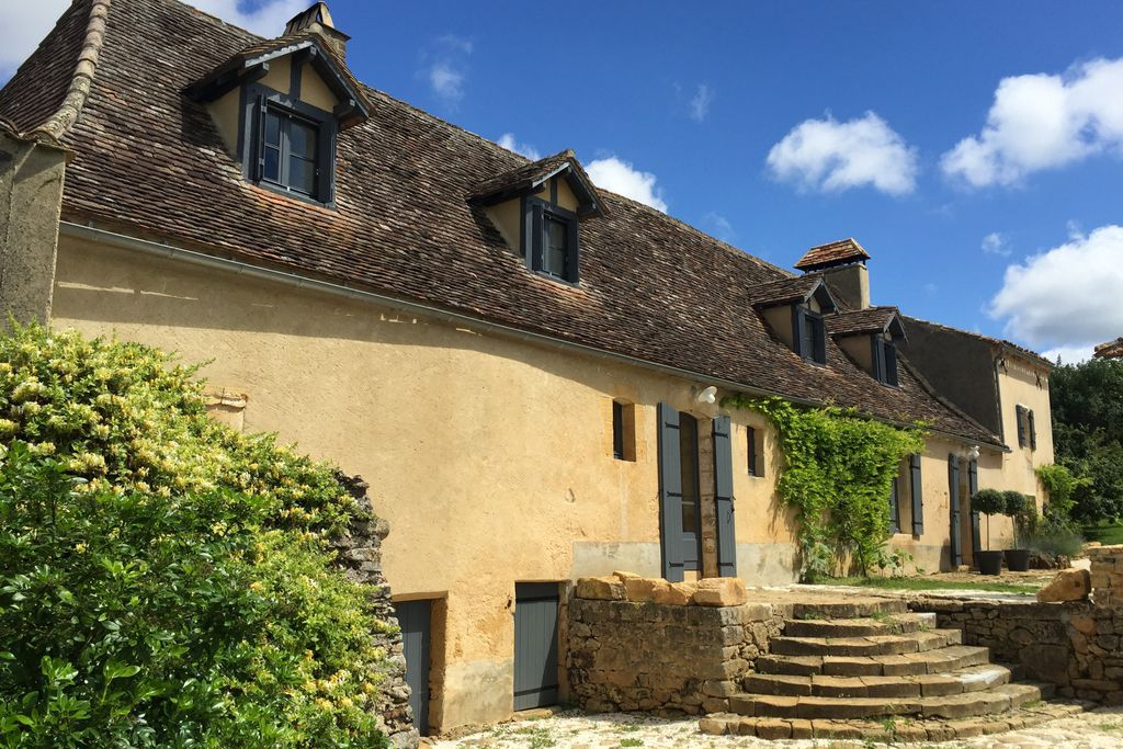 Exterior of Le Mas, with steps leading up to the property, in Dordogne, France