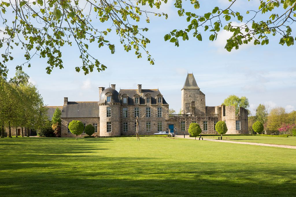 Exterior of Chateau du Bois Guy in Brittany, France with large sunny grounds