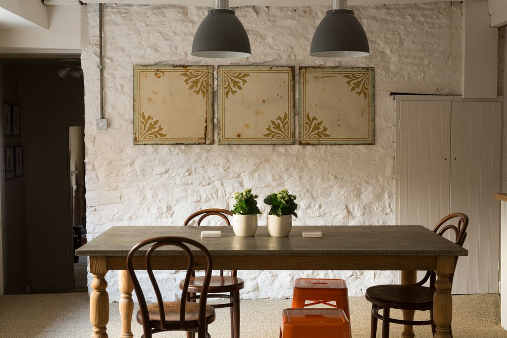 Table for five or six in the open plan kitchen and dining area