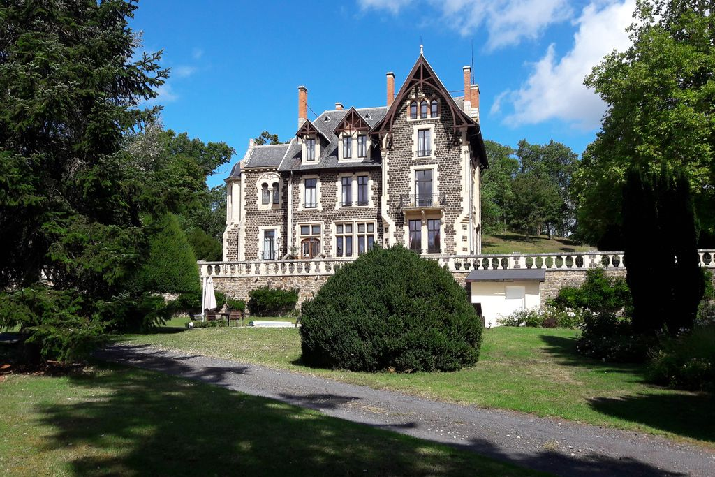 Exterior of Le Manoir d'Alice in Parentignat, Puy-de-Dome in France on a sunny day with beautiful large grounds