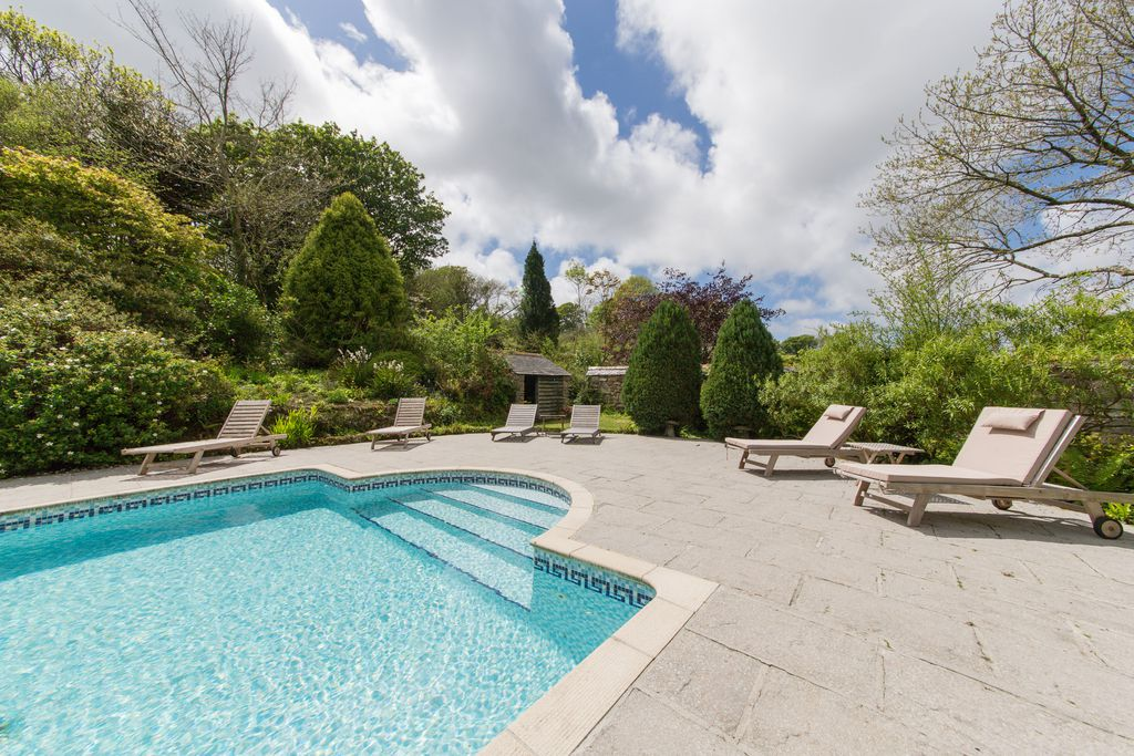 Ennys Cornwall Outside pool with steps leading into the water and sun loungers surrounding the pool area