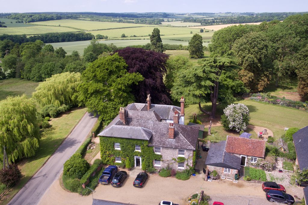 Exterior view of Elmdon Lee in Saffron Walden, Essex from up high with view of large grounds and surrounding countryside