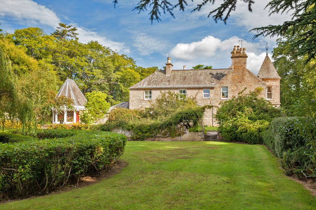 Exterior of Westfield House in Moray, Scotland with large grounds and pretty garden
