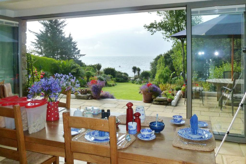 Dining table with bi folding doors leading onto the garden