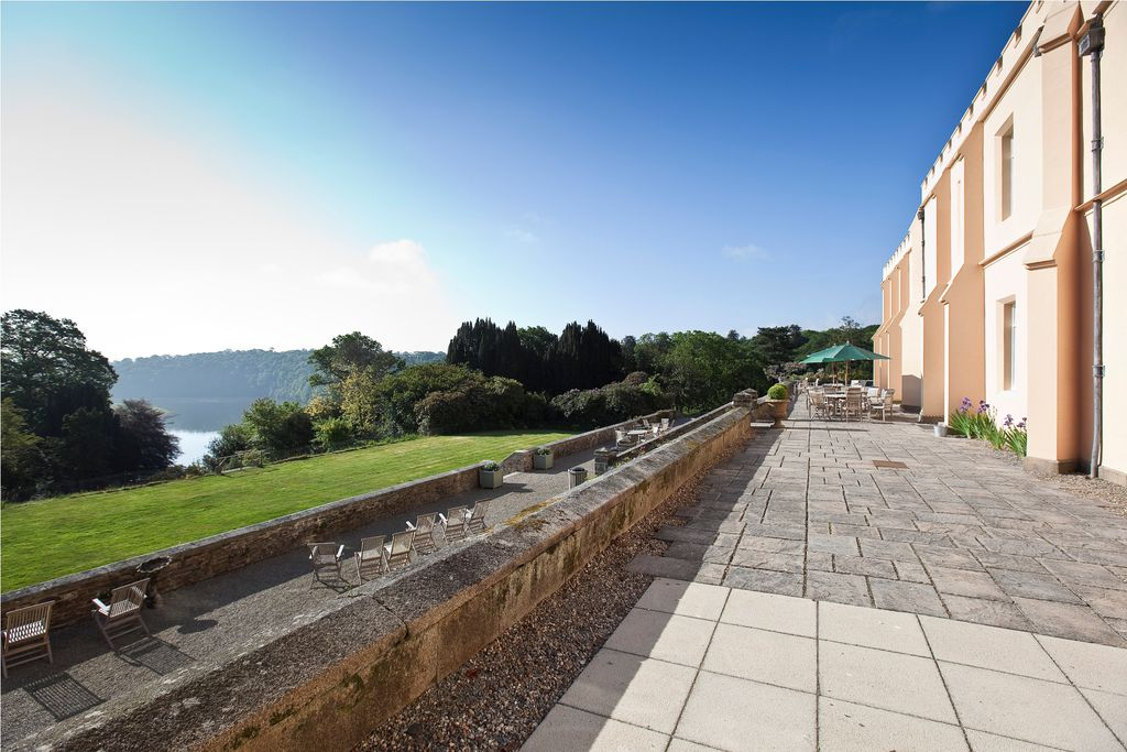 Terrace and gardens at Pentillie Castle B&B in Saltash, Cornwall with views across to the river