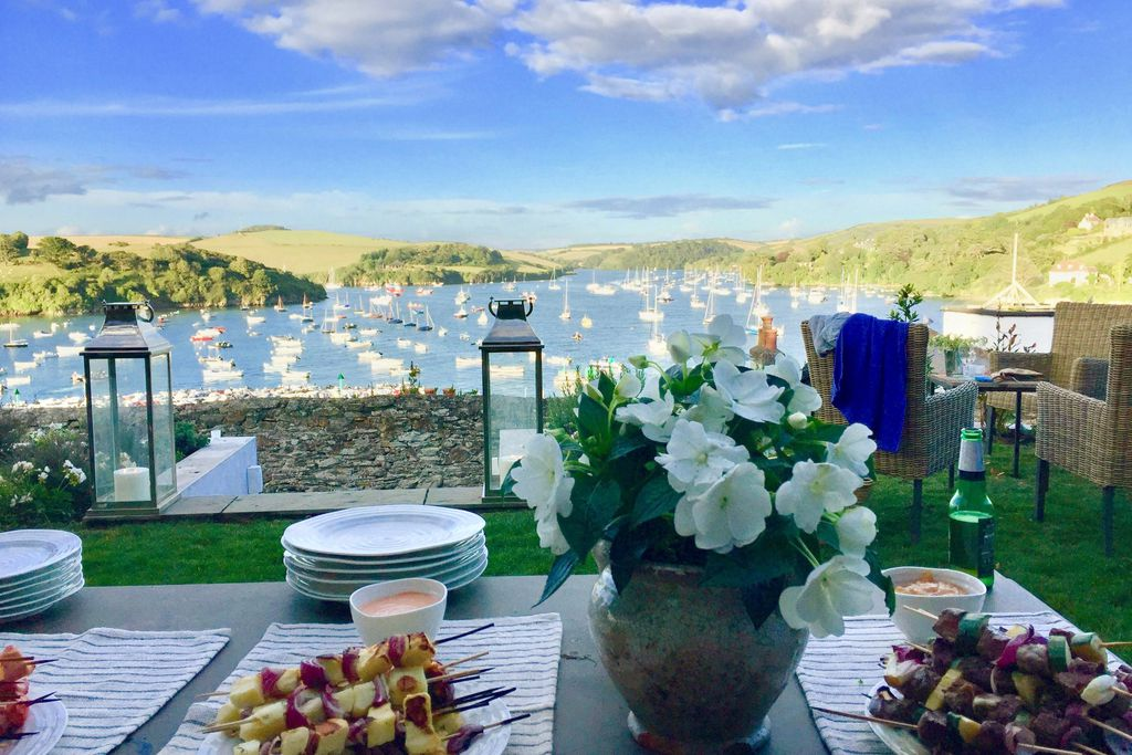 View of Salcombe Harbour from garden at Pitchford House in Salcombe, Devon with table laid for al fresco dining