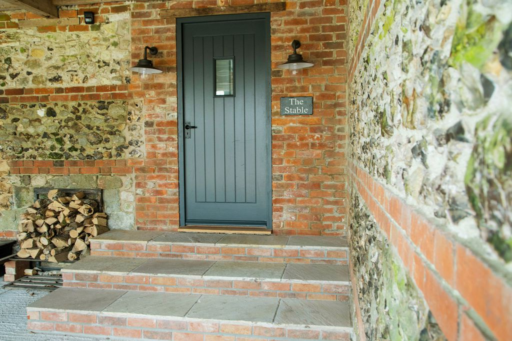 Entrance to The Stable in Broadchalke, Wiltshire with lovely brick exterior
