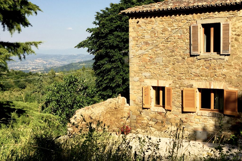 Exterior of Casa sul Monte in Umbria, Italy with views across the mountains and surrounding landscape