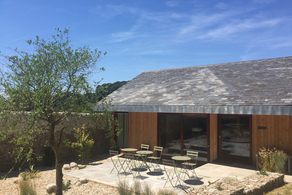 Exterior view of The Wainhouse in Lyme Regis, Dorset - a contemporary barn with lovely outdoor terrace