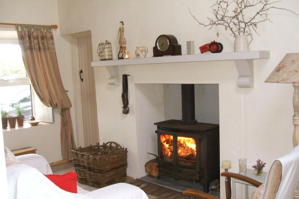 Cosy lounge at Cuach Cottage in Clifden, Co. Galway, Ireland with real wood burner