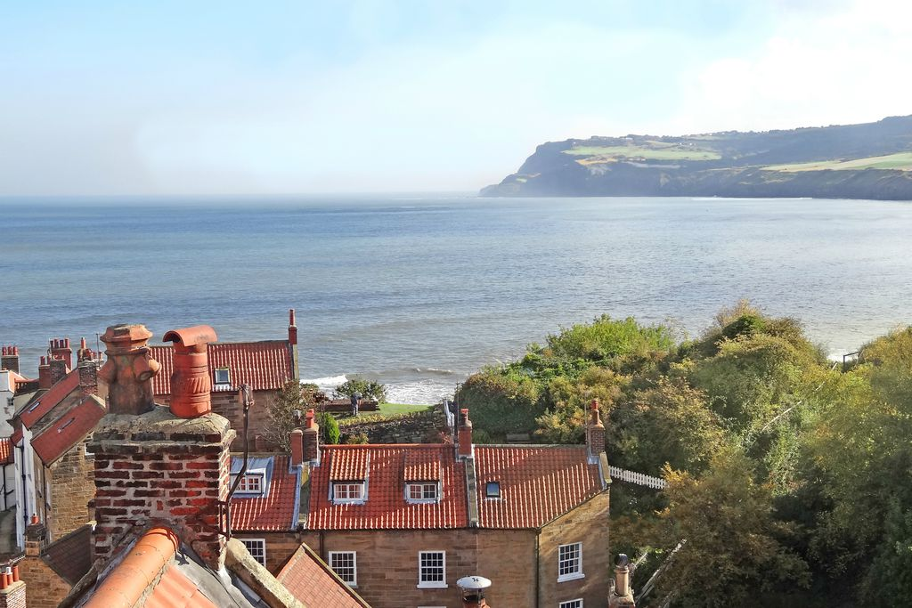 View of the dramatic coastline from top of Greenfield Cottage in Robin Hood's Bay, Yorkshire