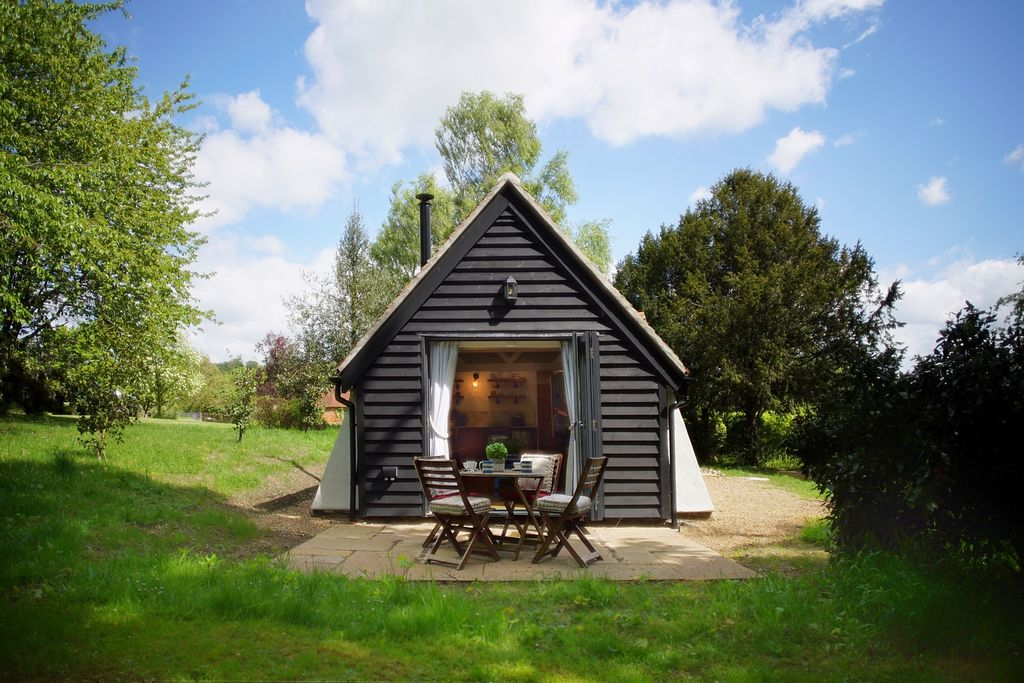 The Snuggery in Rochester, Kent with hut-like front and outdoor terrace with seating for al fresco dining