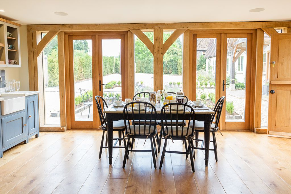 Dining table inside the kitchen looking out at the beautiful garden in The Cottage at Lupton House