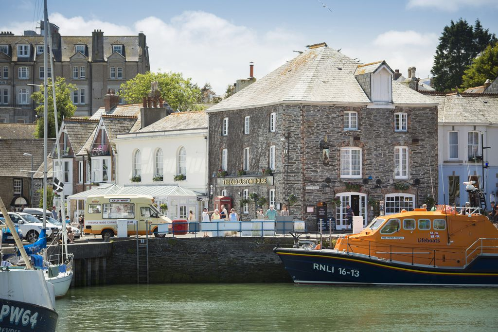 View across Padstow harbour to The Old Custom House Inn situated on the waters edge right in the heart of the town