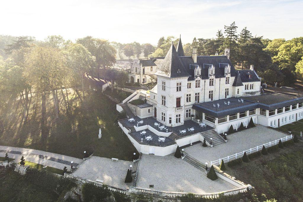 Aerial view of castle like Château Le Prieuréin Maine-et-Loire, Western Loire