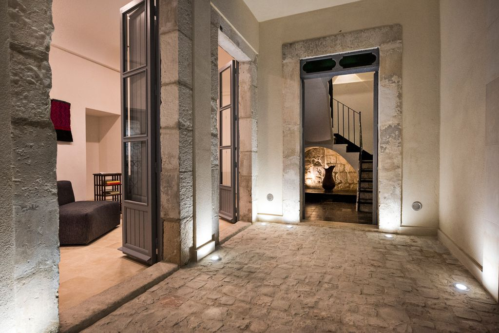 Domus Sbirciò with it's door open in Ragusa, Sicily