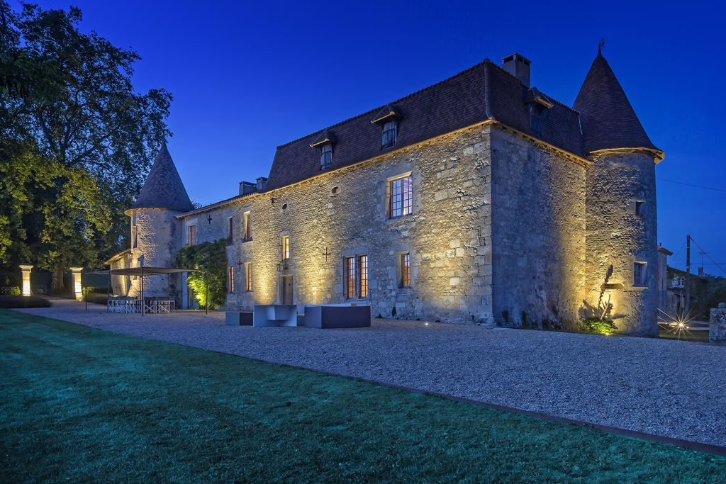 Beautiful, grand Chateau de Lerse in Cherente, France lit up at night