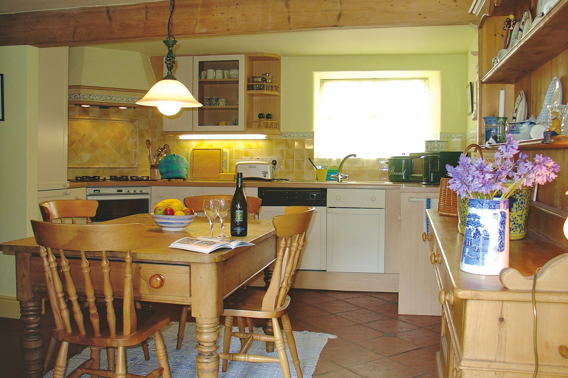 Traditional cottage kitchen with with farmhouse table
