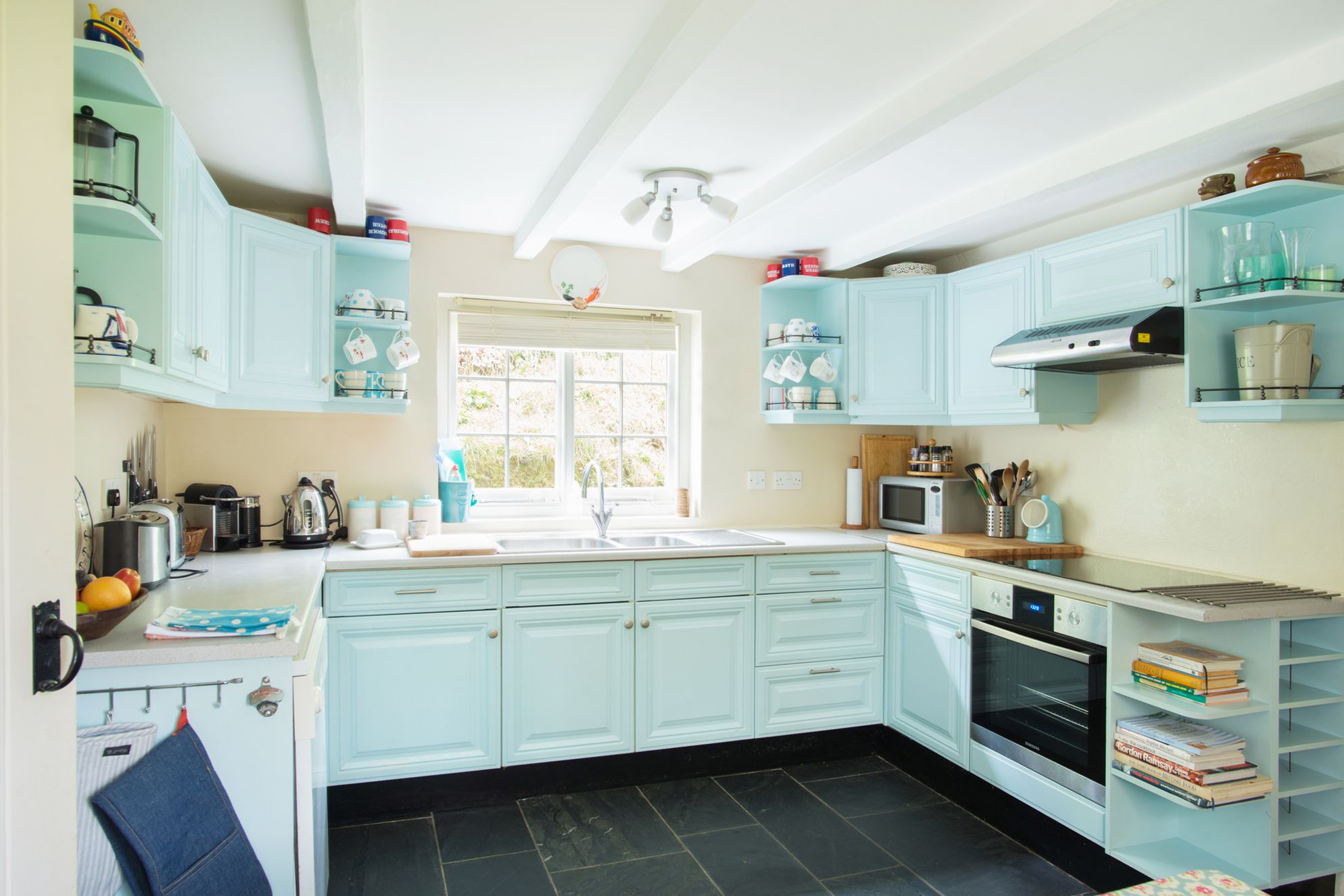 Penpoll's neat and tidy blue kitchen in Fowey Cornwall