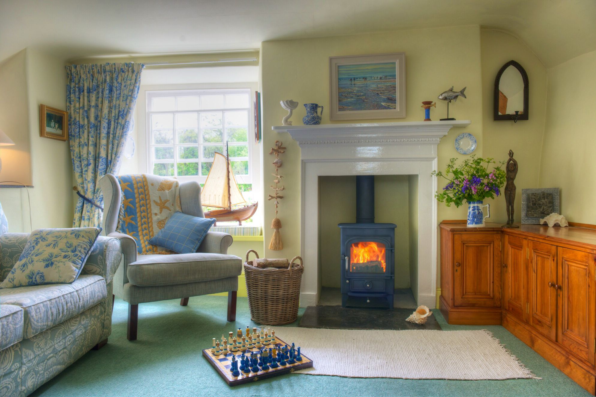 School Cottage Cornwall sitting room with log burner and traditional features