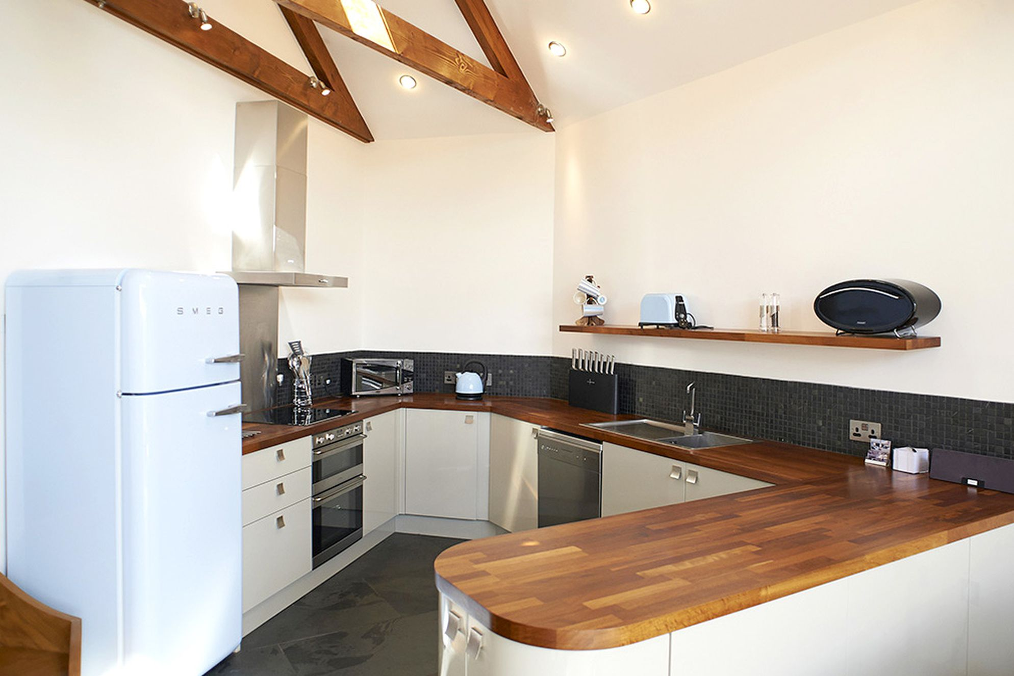 Merlin Farm Cornwall modern style kitchen with Smeg fridge