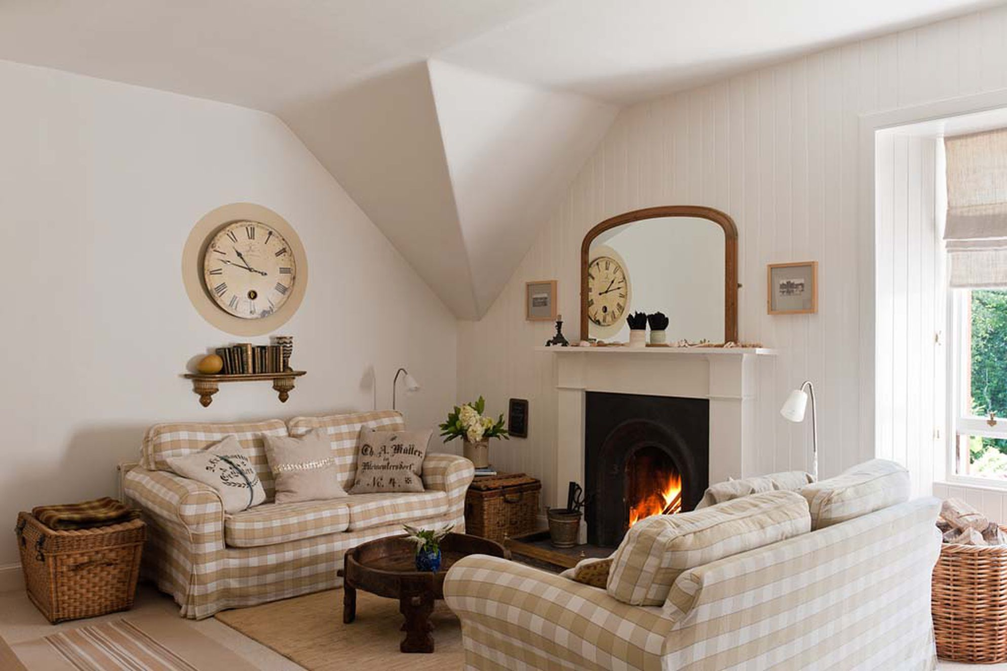 Cosy sitting room with a fire burning at The Rookery in Scotland