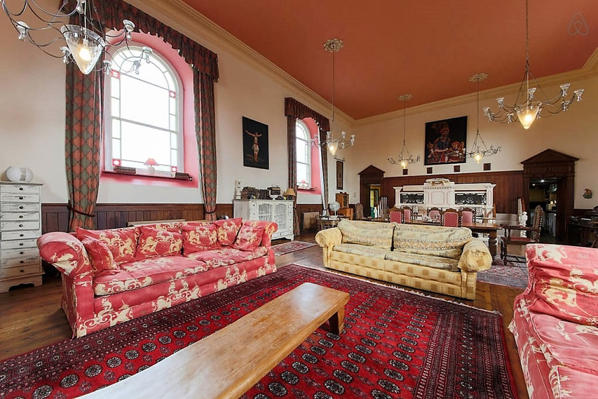 Large living room lit by traditional chapel windows