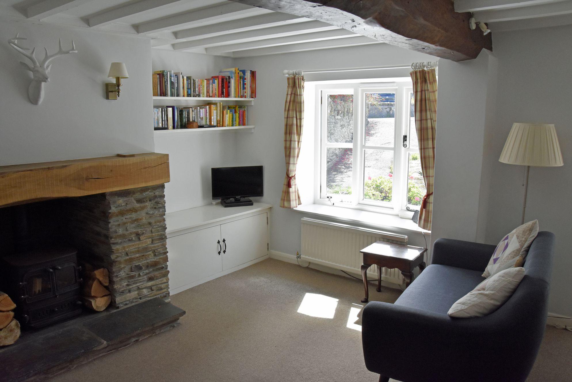 Old Post Cottage Devon, living area with television and log burner