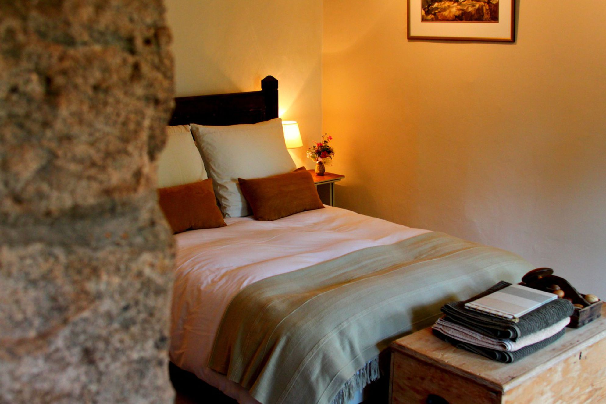 Cosy bedroom with double bed and storage