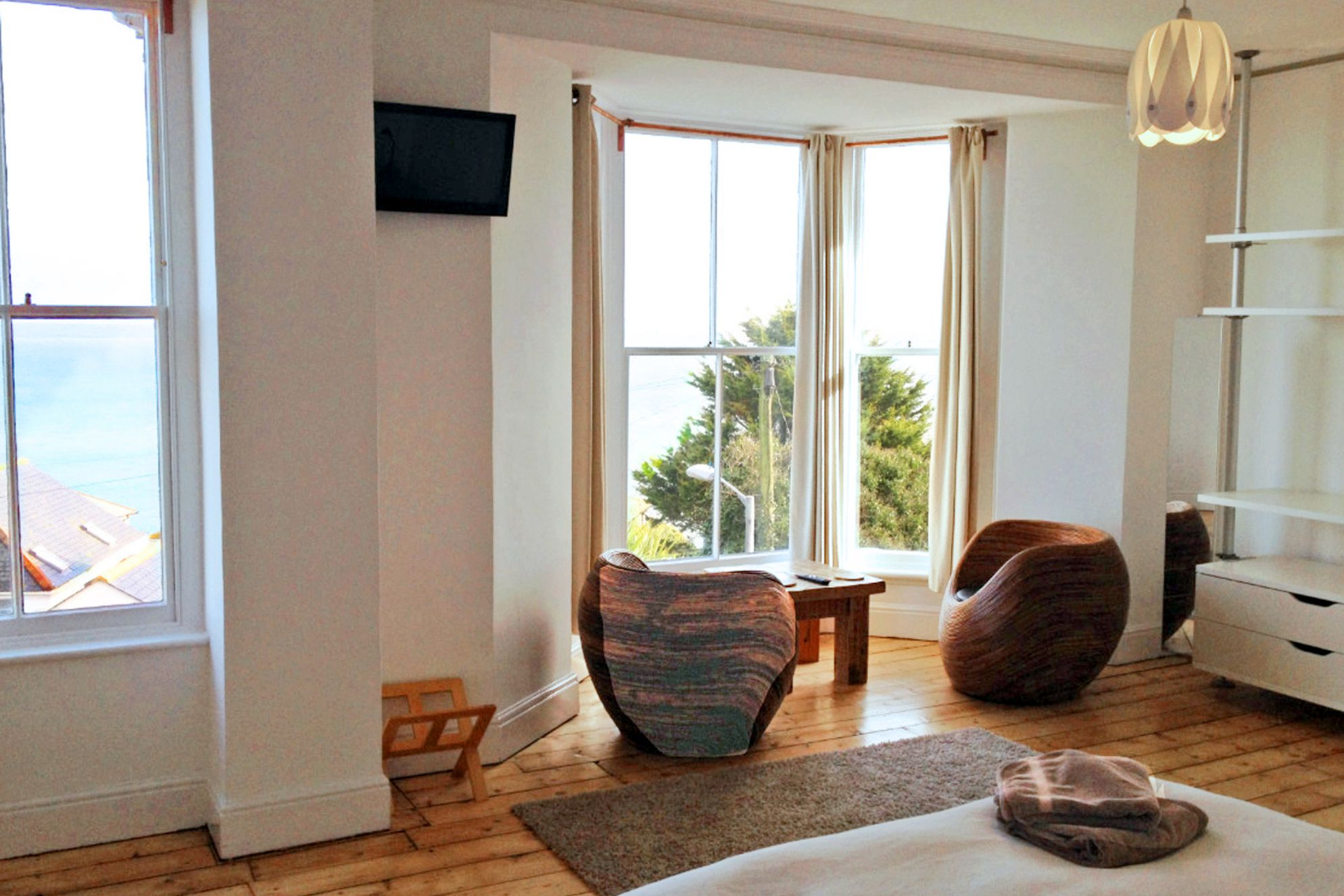 Double bedroom with seating area looking out of the bay window