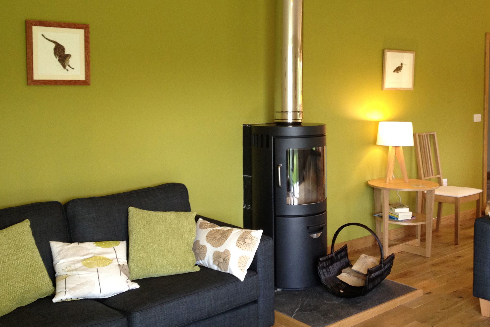 Cosy lounge with a modern log burner