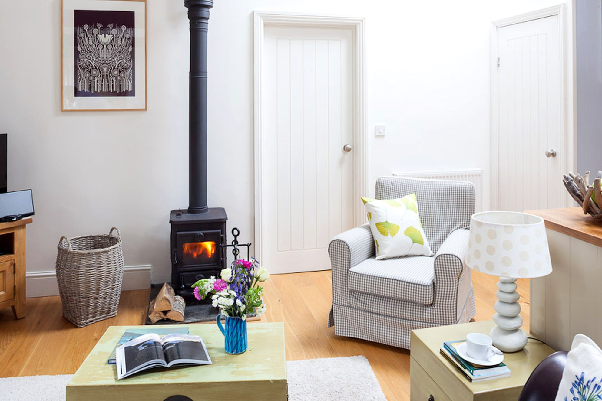 Cosy sitting room with log burner at Bolotho Barns, Skylarks in Cornwall