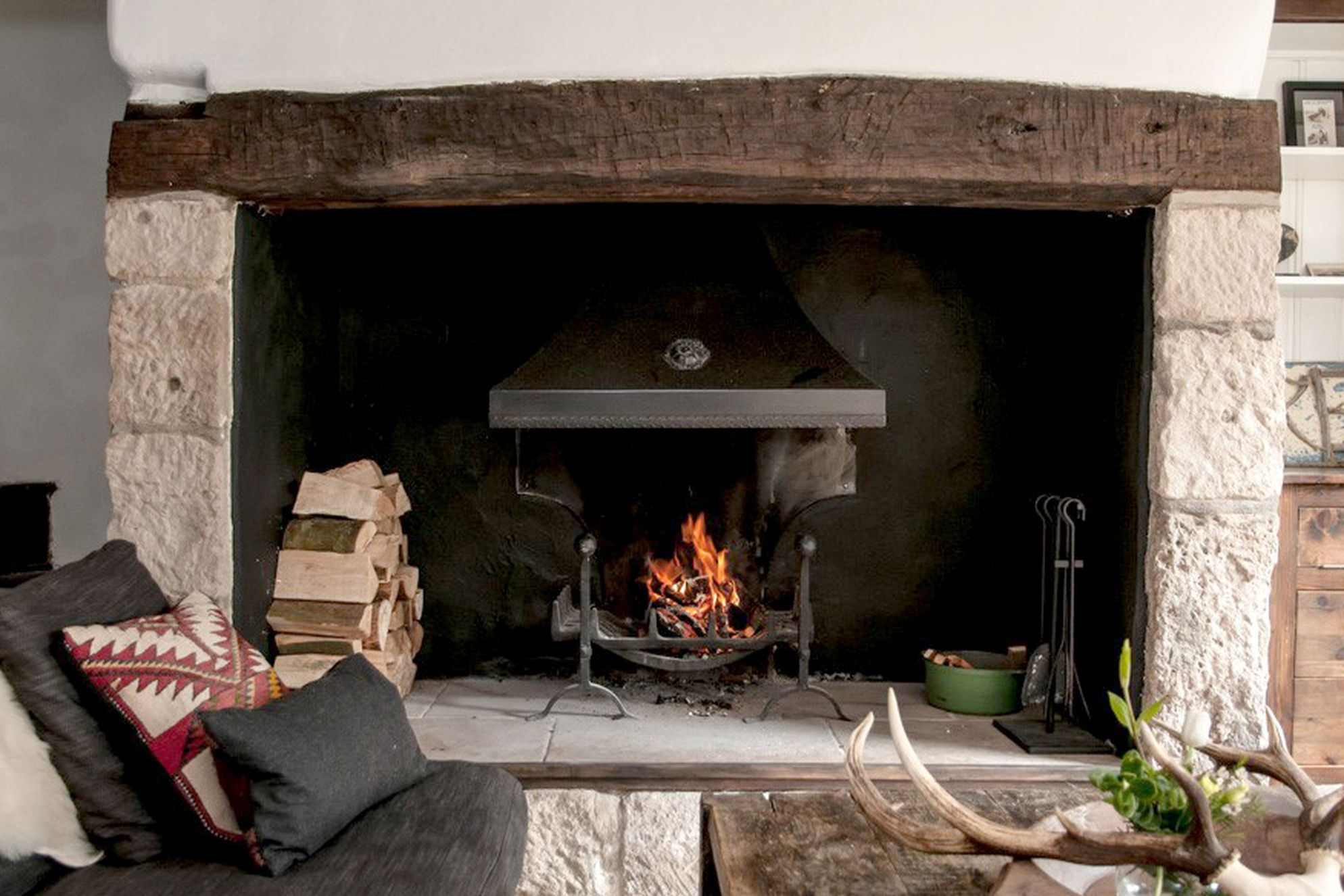Open fire alight in the cosy sitting room at 62 Mallams in Devon