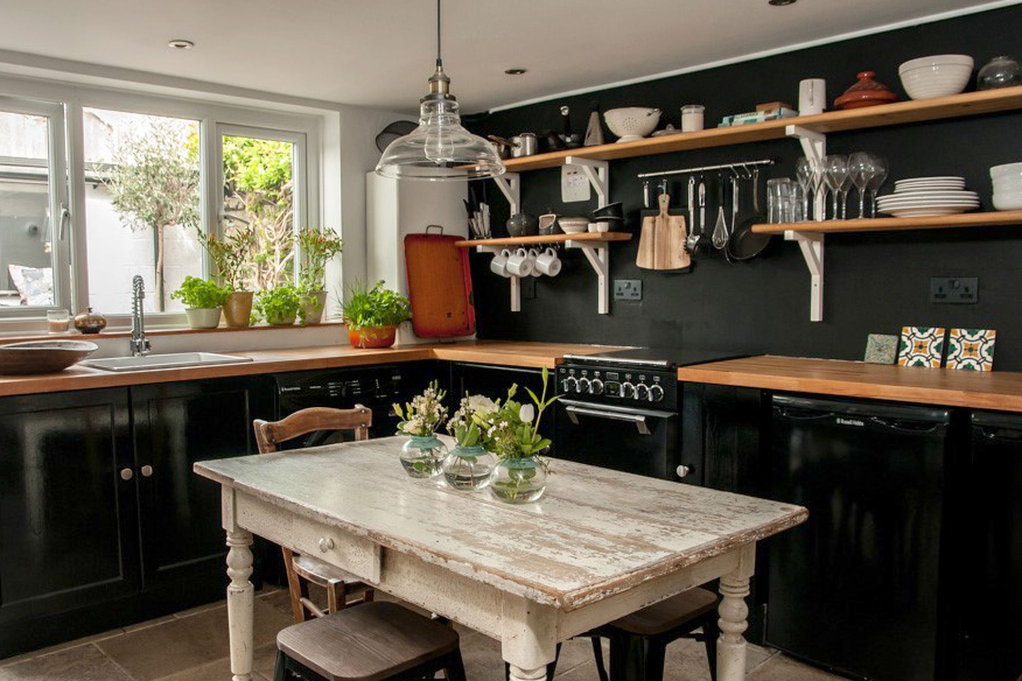 Stylish kitchen with dining table