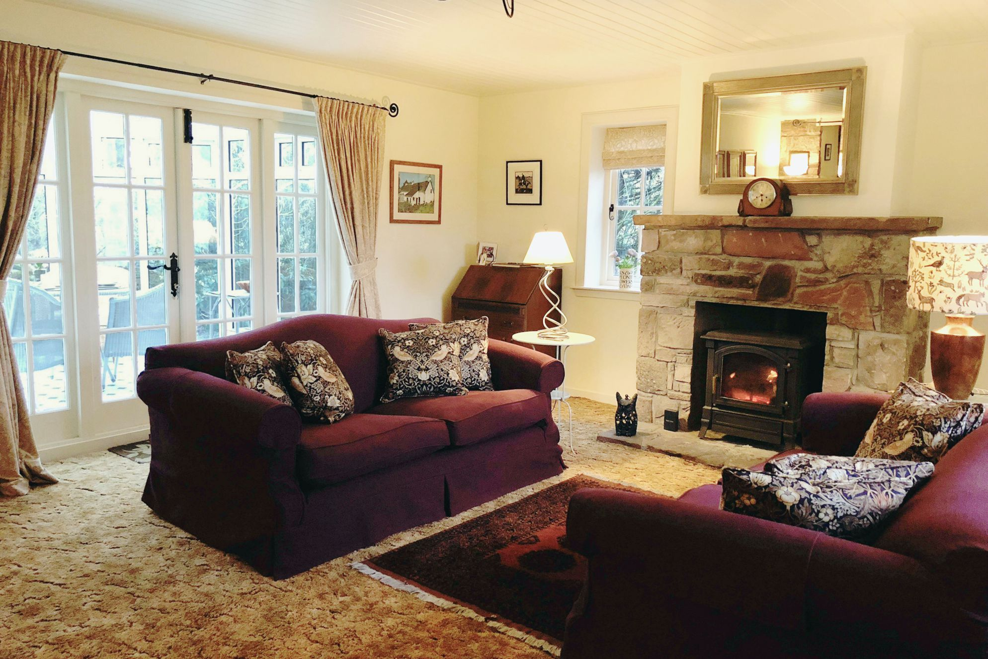 Cosy and warm living area at The Lint Mill in Lanarkshire with wood burner