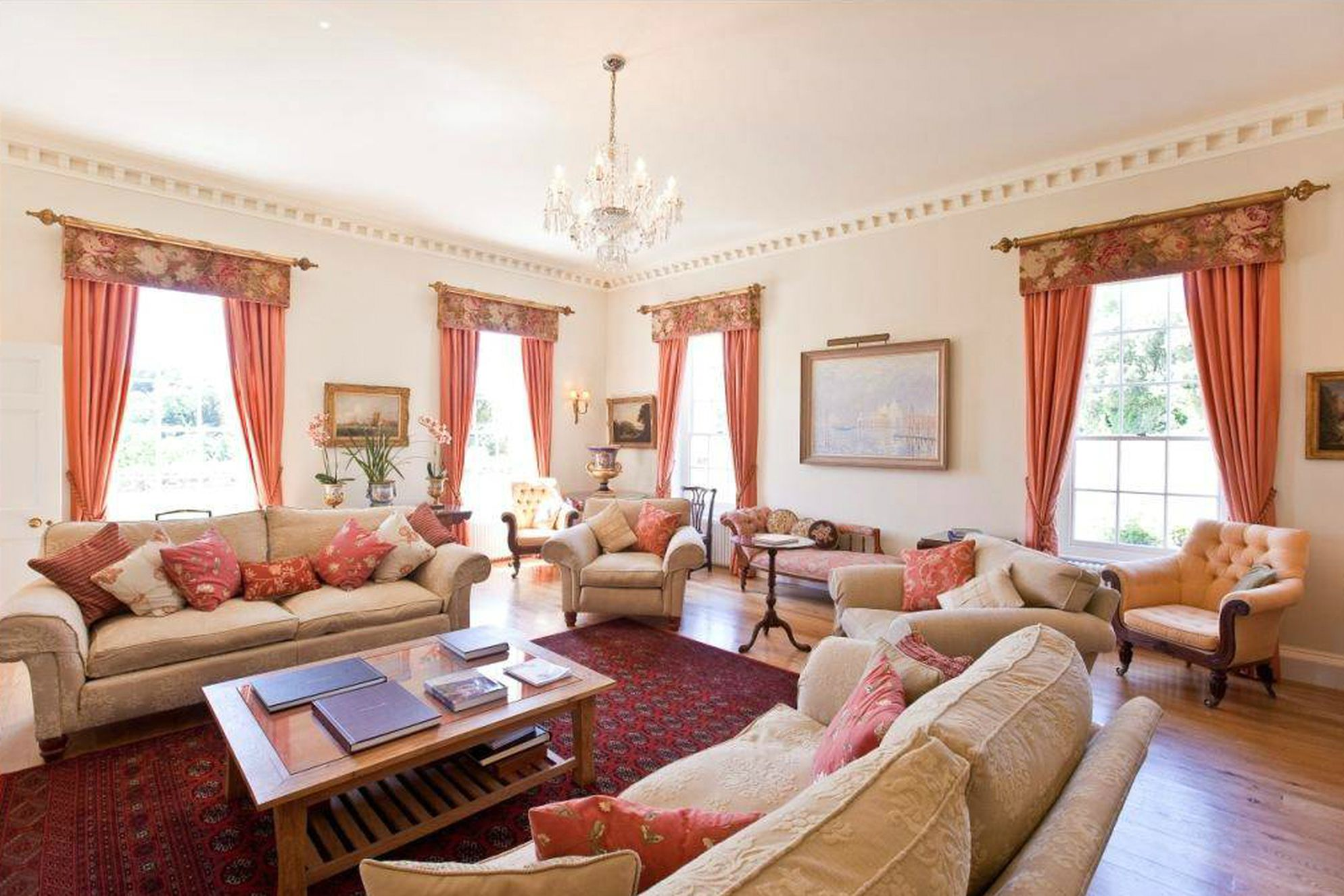 Living area at Pentillie Castle in Saltash, Cornwall with plenty of seating and comfy sofas
