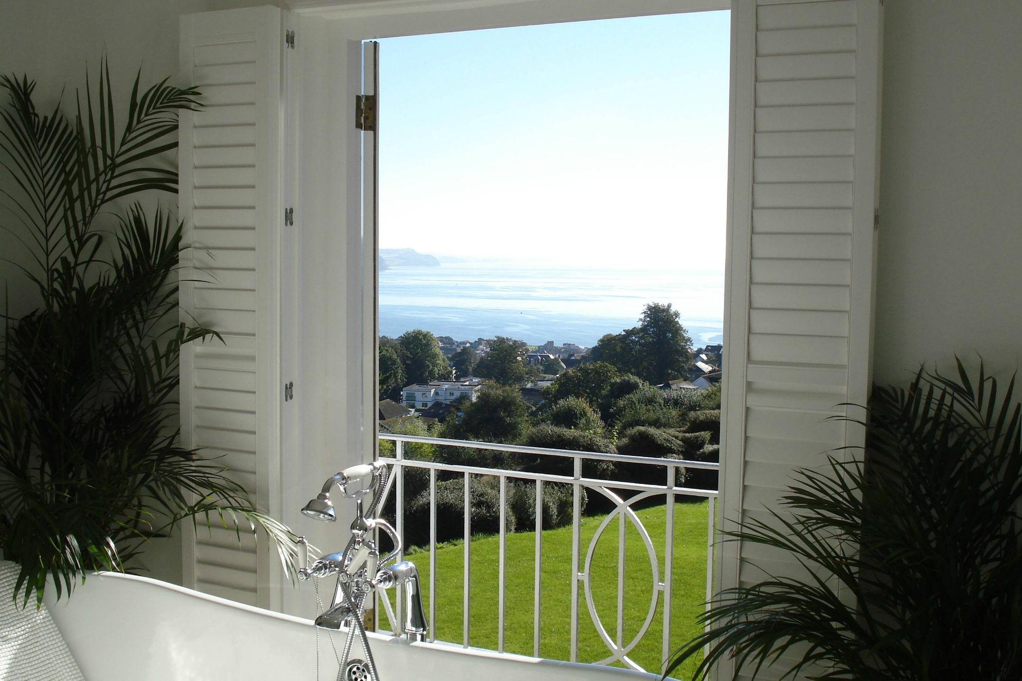 Incredible view of the sea from the luxurious bathtub in the bathroom at Greenhill House in Lyme Regis, Dorset, sitting up on the hill